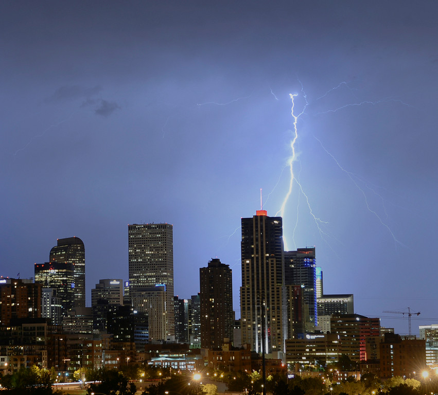 . A bolt of lightning illuminated the sky behind downtown Denver late Thursday night, June 5, 2014. (Photo by Karl Gehring/The Denver Post)