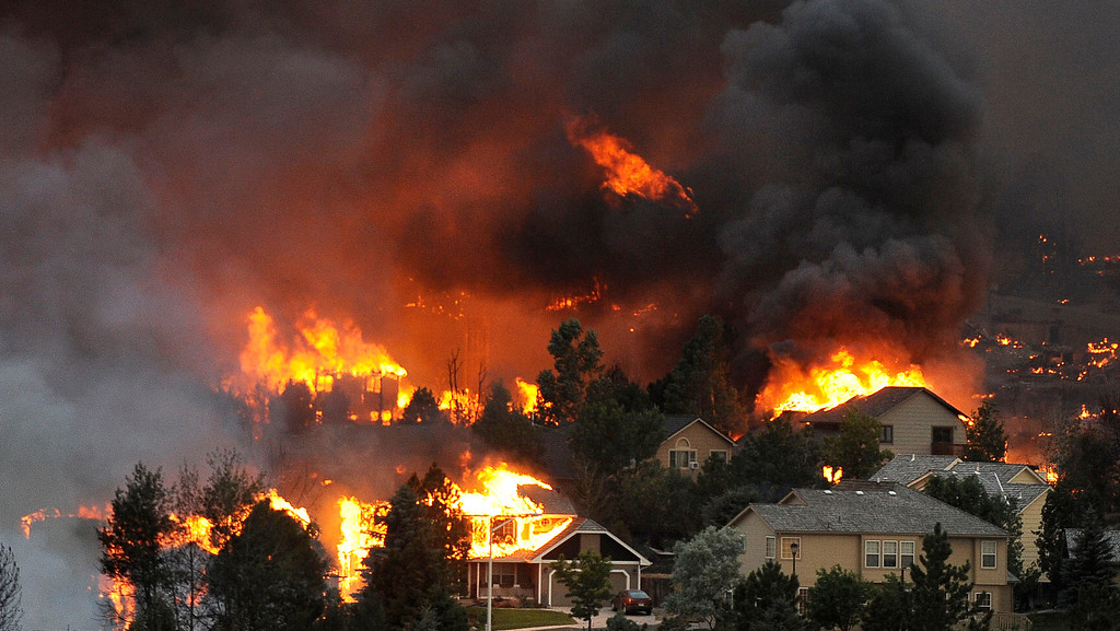. An entire neighborhood burns near the foothills of Colorado Springs as the Waldo Canyon Fire raced into the Mountain Shadows subdivision. Helen H. Richardson, The Denver Post
