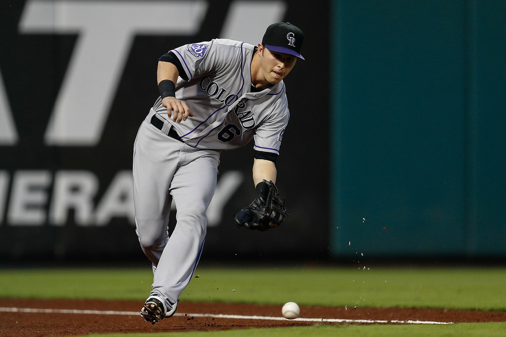 . PHILADELPHIA, PA - AUGUST 22: Corey Dickerson #6 of the Colorado Rockies fields the ball in the second inning of the game against the Philadelphia Phillies at Citizens Bank Park on August 22, 2013 in Philadelphia, Pennsylvania. (Photo by Brian Garfinkel/Getty Images)