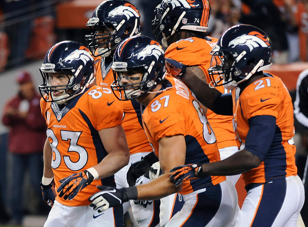 . Denver Broncos wide receiver Wes Welker has a convoy on congratulators after he caught a touchdown pass from Peyton Manning in the second quarter. The Denver Broncos took on the Oakland Raiders at Sports Authority Field at Mile High in Denver on September 23, 2013. (Photo by Steve Nehf/The Denver Post)