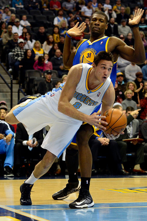 . Denver Nuggets small forward Danilo Gallinari (8) drives past Golden State Warriors center Festus Ezeli (31) during the first half at the Pepsi Center on Sunday, January 13, 2013. AAron Ontiveroz, The Denver Post