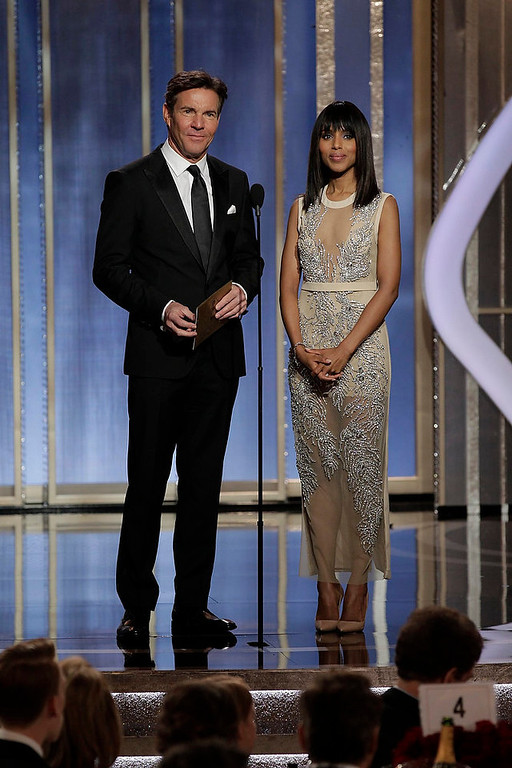 . Presenters Dennis Quaid (L) and Kerry Washington on stage at the 70th annual Golden Globe Awards in Beverly Hills, California January 13, 2013, in this picture provided by NBC. REUTERS/Paul Drinkwater/NBC/Handout