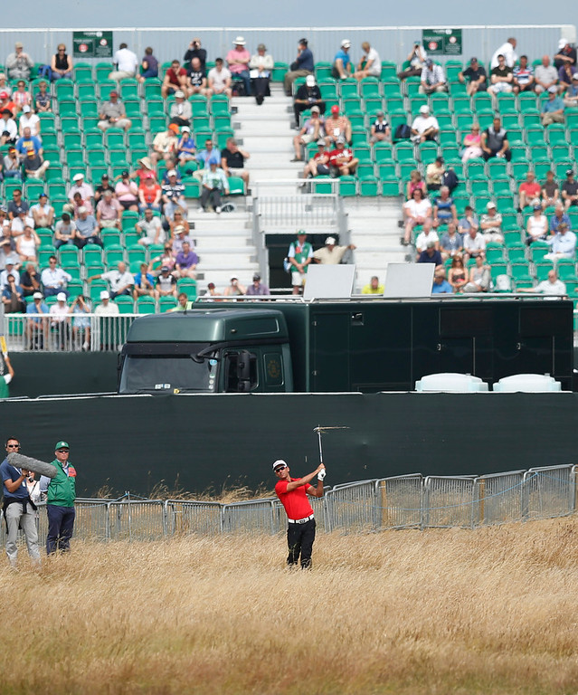 . Rafael Cabrera-Bello of Spain plays out of the rough on the 18th hole during the first round of the British Open Golf Championship at Muirfield, Scotland, Thursday July 18, 2013. (AP Photo/Matt Dunham)