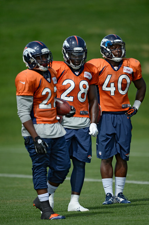 . Denver Broncos running back C.J. Anderson (22) Denver Broncos running back Montee Ball (28) and Denver Broncos running back Juwan Thompson (40) watch drills during practice August 26, 2014 at Dove Valley.(Photo by John Leyba/The Denver Post)
