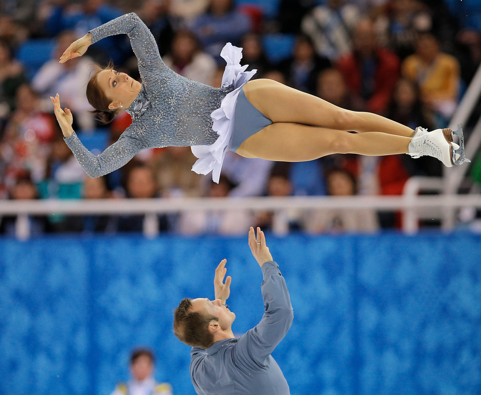 Description of . Maylin Wende and Daniel Wende of Germany compete in the pairs short program figure skating competition at the Iceberg Skating Palace during the 2014 Winter Olympics, Tuesday, Feb. 11, 2014, in Sochi, Russia. (AP Photo/Vadim Ghirda)
