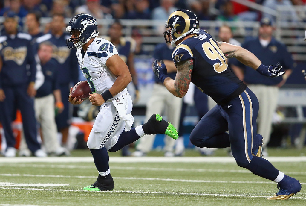 . Russell Wilson #3 of the Seattle Seahawks runs with the ball during the NFL game against the St. Louis Rams at Edward Jones Dome on October 28, 2013 in St Louis, Missouri.  (Photo by Andy Lyons/Getty Images)