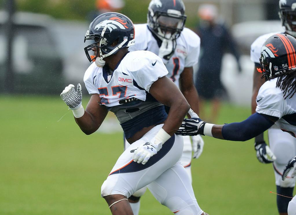 . Denver Broncos linebacker Steven Johnson (53) runs through drills on day seven of the Denver Broncos 2014 training camp July 31, 2014 at Dove Valley. (Photo by John Leyba/The Denver Post)
