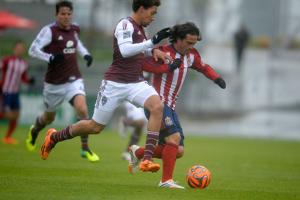 . Mauro Rosales (7) of Chivas USA controls the ball against Chris Klute (15) of Colorado Rapids during the second half. Chivas USA defeated the Colorado Rapids 3-1 on Sunday, May 11, 2014. (Photo by AAron Ontiveroz/The Denver Post)