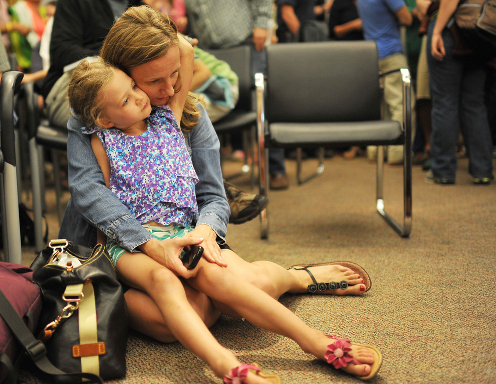 . BOULDER, CO - September 18 : Evacuee Jamie Vandenberg holds her daughter Mia, 4, during a meeting for Jamestown residents at the Boulder County Commissioners building. Boulder, Colorado. September 18, 2013.  (Photo by Hyoung Chang/The Denver Post)