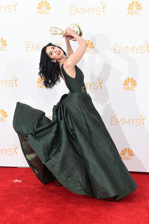 """. Writer-Comedian Sarah Silverman, winner of the Outstanding Writing for a Variety Special  Award for \""""Sarah Silverman: We Are Miracles\"""", poses in the press room during the 66th Annual Primetime Emmy Awards held at Nokia Theatre L.A. Live on August 25, 2014 in Los Angeles, California.  (Photo by Jason Merritt/Getty Images)"""