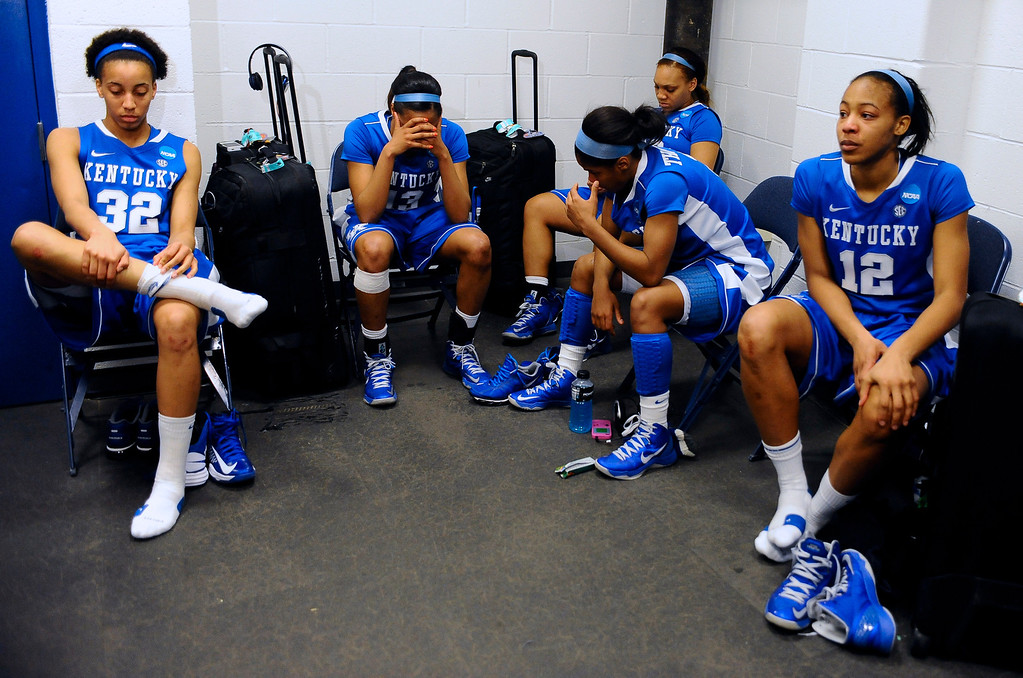 . Kentucky\'s Kastine Evans, from left, Bria Goss, DeNesha Stallworth, Janee Thompson and Jelleah Sidney react in the locker room after losing a regional final game against Connecticut in the women\'s NCAA college basketball tournament in Bridgeport, Conn., Monday, April 1, 2013. Connecticut won 83-53. (AP Photo/Jessica Hill)