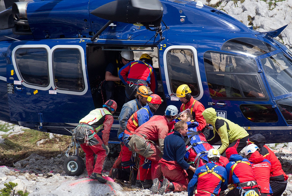 . Mountain rescue workers carry injured German speleologist Johann Westhauser (C) to a helicopter outside the Riesending cave complex near Marktschellenberg, southern Germany on June 19, 2014, ending his 11-day ordeal and a massive recovery operation deep below the Bavarian Alps. Westhauser, 52, suffered serious head injuries in the accident about 1,000 metres (3,300 feet) below ground in the Riesending cave complex, Germany\'s longest and deepest.   AFP PHOTO / DPA/ NICOLAS ARMER/AFP/Getty Images