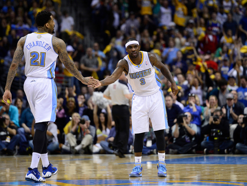 . Denver Nuggets point guard Ty Lawson (3) and Denver Nuggets shooting guard Wilson Chandler (21) high-five after a basket. The Denver Nuggets took on the Golden State Warriors in Game 5 of the Western Conference First Round Series at the Pepsi Center in Denver, Colo. on April 30, 2013. (Photo by AAron Ontiveroz/The Denver Post)