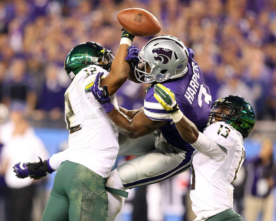 . Kansas State Wildcats wide receiver Chris Harper (3) has his touchdown pass broken up by Oregon Ducks defensive back Brian Jackson (12) and Troy Hill (13) in the first half during the Fiesta Bowl football game in Glendale, Arizona, January 3, 2013. REUTERS/Darryl Webb