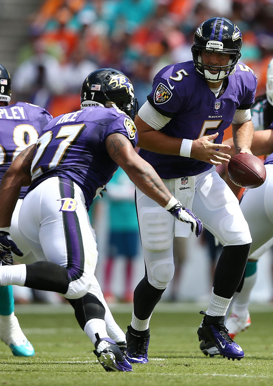. Baltimore Ravens quarterback Joe Flacco (5) looks to hand off  to Ray Rice (27) during the first half of an NFL football game against the Miami Dolphins, Sunday, Oct. 6, 2013, in Miami Gardens, Fla. (AP Photo/J Pat Carter)
