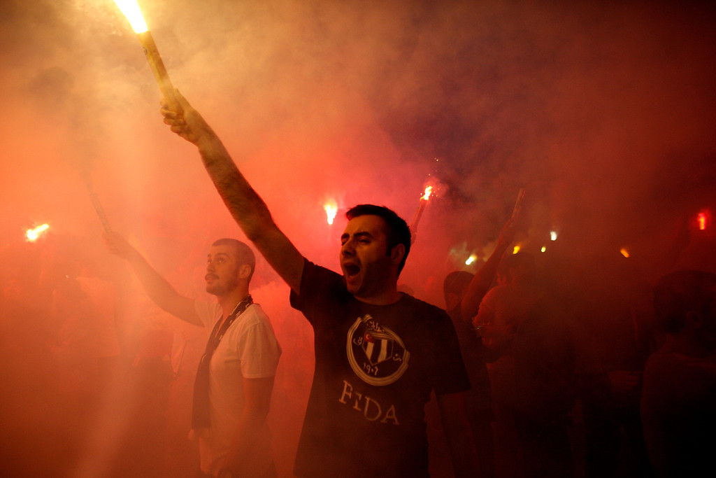 . Protesters light flares and shout slogans during a protest  at Taksim square in Istanbul, Tuesday, June 4, 2013.  (AP Photo/Kostas Tsironis)