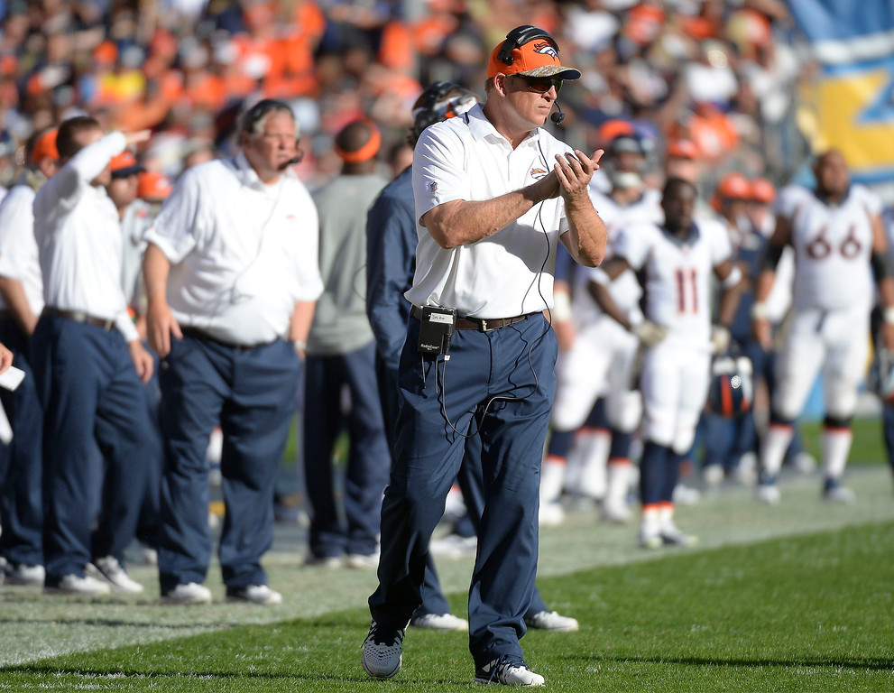 . Denver Broncos interim coach Jack Del Rio cheers his team on during the second quarter against the San Diego Chargers at Qualcomm Stadium. (Photo by John Leyba/The Denver Post)