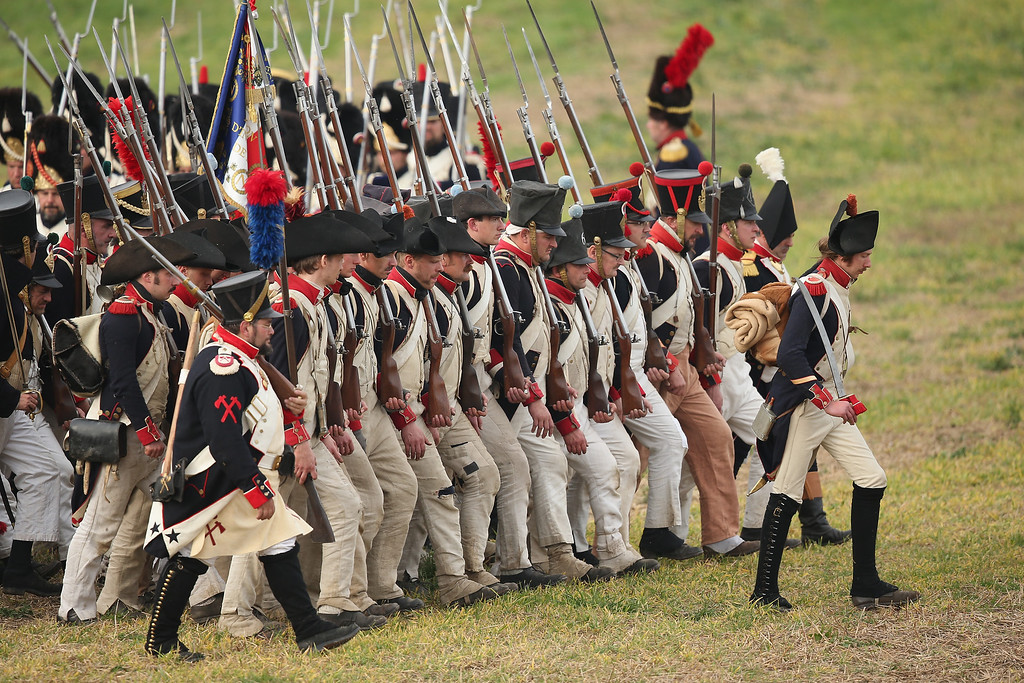 . Historical society enthusiasts in the role of French troops loyal to Napoleon prepare to advance against the enemy during the re-enactment of The Battle of Nations on its 200th anniversary on October 20, 2013 near Leipzig, Germany.  (Photo by Sean Gallup/Getty Images)