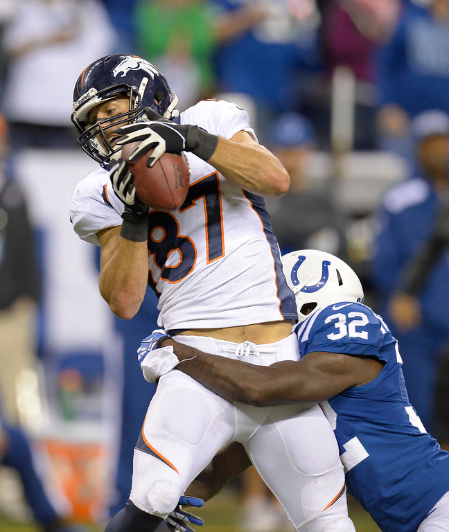 . Denver Broncos wide receiver Eric Decker (87) catches a Peyton Manning catch as Indianapolis Colts cornerback Cassius Vaughn (32) hangs all over him during the fourth quarter October 20, 2013 at Lucas Oil Field. Photo by John Leyba/The Denver Post)