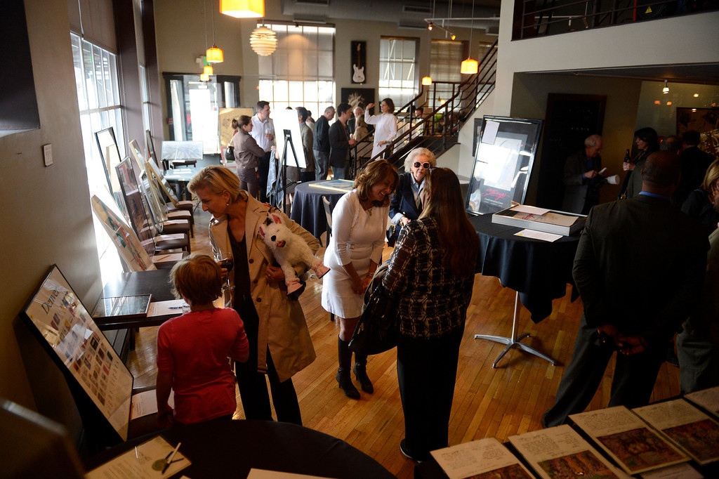 . DENVER, CO. - APRIL 30:  Tammy Cunningham, owner of Strings Restaurant greets guests as they browse through the art work on auction after the last day of service as the Denver favorite closes April 30, 2013 Denver, Colorado. (Photo By Joe Amon/The Denver Post)