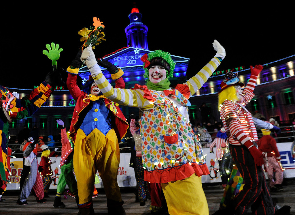 . DENVER, CO. - DECEMBER 06: Denver\'s clown community shared smiles with crowd as the 9News Parade of Lights kicked off Friday night, December 6, 2013. The weather was clear but temperatures dipped below zero. Photo By Karl Gehring/The Denver Post