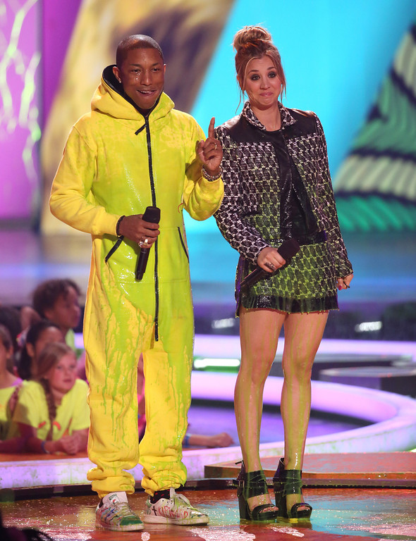 . Pharrell Williams, left, and Kaley Cuoco present the award for favorite female singer at the 27th annual Kids\' Choice Awards at the Galen Center on Saturday, March 29, 2014, in Los Angeles. (Photo by Matt Sayles/Invision/AP)