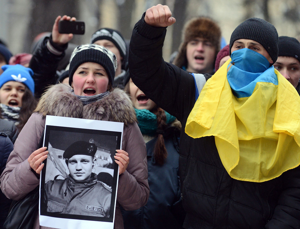 . Ukrainians shout slogans during a ceremony in the western city of Lviv on January 23, 2014 in memory of protesters killed in clashes with riot police.  AFP PHOTO/  YURIY  DYACHYSHYN/AFP/Getty Images