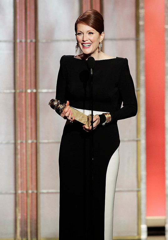 ". This image released by NBC shows actress Julianne Moore, winner of the award for best actress in a mini-series or TV movie for her role in ""Game Change,\"" on stage during the 70th Annual Golden Globe Awards at the Beverly Hilton Hotel on Jan. 13, 2013, in Beverly Hills, Calif. (AP Photo/NBC, Paul Drinkwater)"