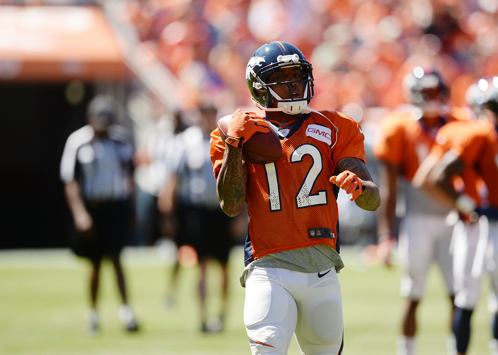 . Andre Caldwell of Denver Broncos (12) is warming up for the Broncos scrimmage at Sports Authority Field at Mile High. Denver, Colorado. August 02. 2014. (Photo by Hyoung Chang/The Denver Post)