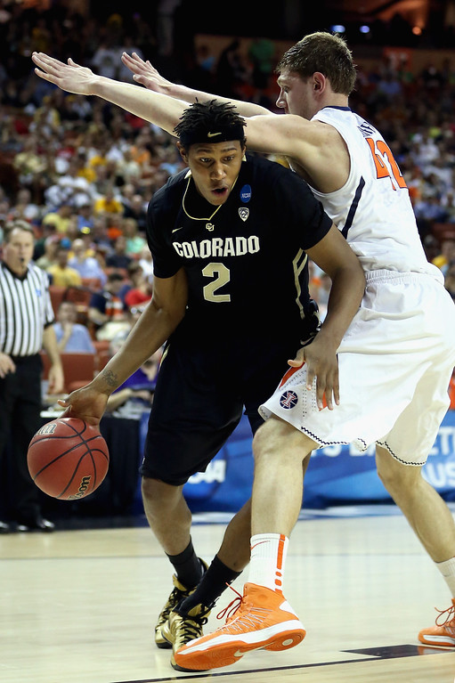 . AUSTIN, TX - MARCH 22:  Xavier Johnson #2 of the Colorado Buffaloes dribbles around Tyler Griffey #42 of the Illinois Fighting Illini during the second round of the 2013 NCAA Men\'s Basketball Tournament at The Frank Erwin Center on March 22, 2013 in Austin, Texas.  (Photo by Ronald Martinez/Getty Images)