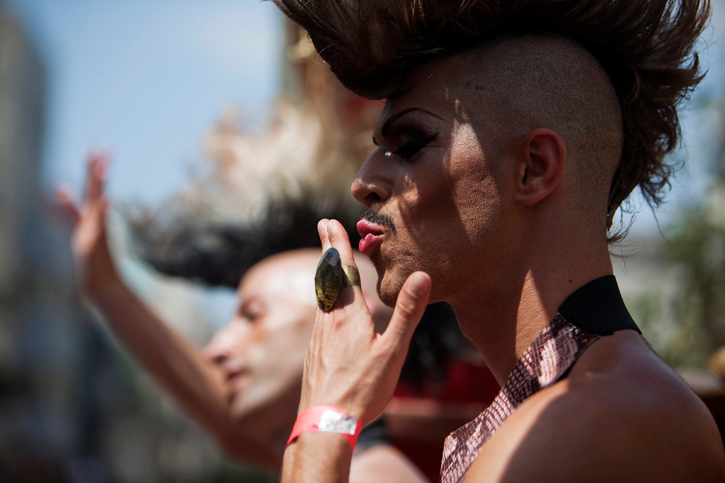 . A dancer gestures to the crowd as he takes part in the annual Gay Pride parade in Tel Aviv June 7, 2013.  REUTERS/Nir Elias