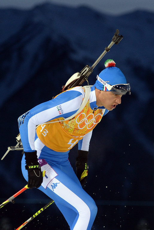 . Dominik Windisch of Italy in action during the Mixed Relay competition at the Laura Cross Biathlon Center during the Sochi 2014 Olympic Games, Krasnaya Polyana, Russia, 19 February 2014.  EPA/HENDRIK SCHMIDT
