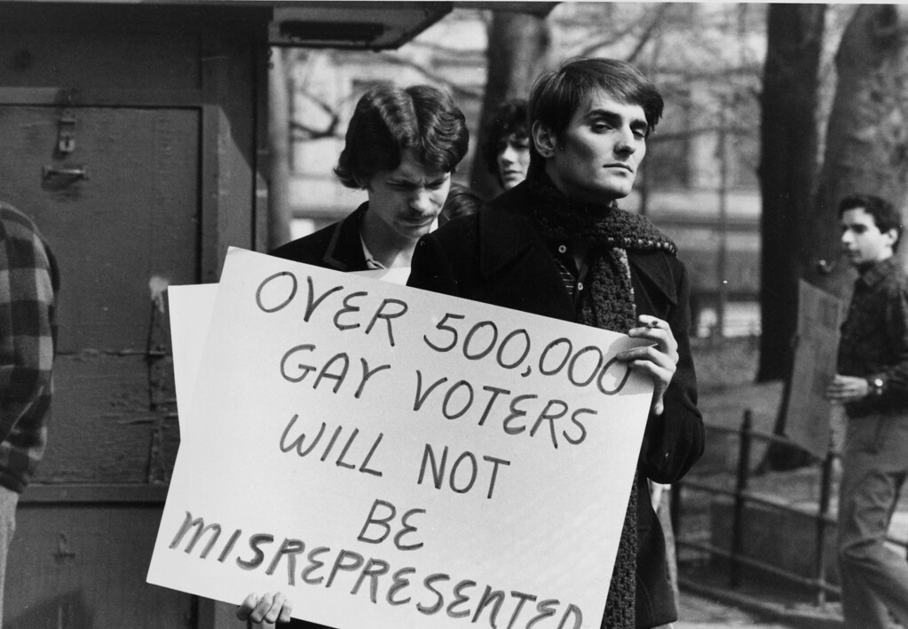 ". A demonstrator carries a sign as he marches with others in a picket line at City Hall calling for the protection of rights for homosexuals, June 10, 1970, in New York City. The signs reads: ""Over 500,000 gay voters will not be misrepresented.\""   (AP Photo/Eddie Adams)"