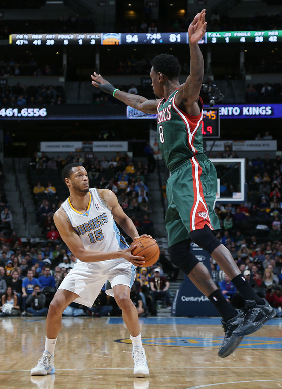 . Denver Nuggets forward Anthony Randolph, left, looks to pass as Milwaukee Bucks center Larry Sanders leaps during the fourth quarter of the Nuggets\' 110-100 victory in an NBA basketball game in Denver on Wednesday, Feb. 5, 2014. (AP Photo/David Zalubowski)