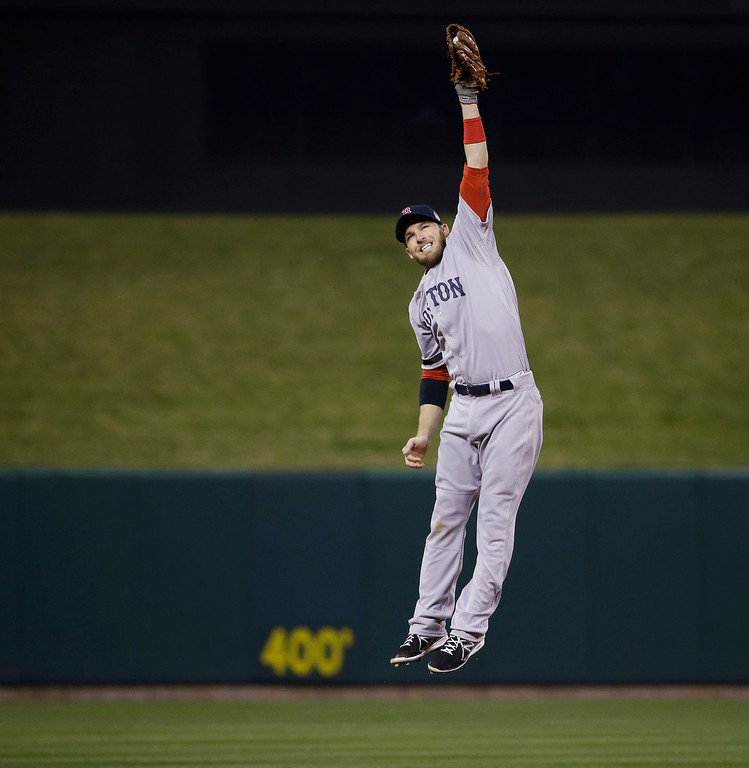 . Boston Red Sox shortstop Stephen Drew catches a hit by St. Louis Cardinals catcher Yadier Molina during the fourth inning of Game 5 of baseball\'s World Series Monday, Oct. 28, 2013, in St. Louis. (AP Photo/Matt Slocum)