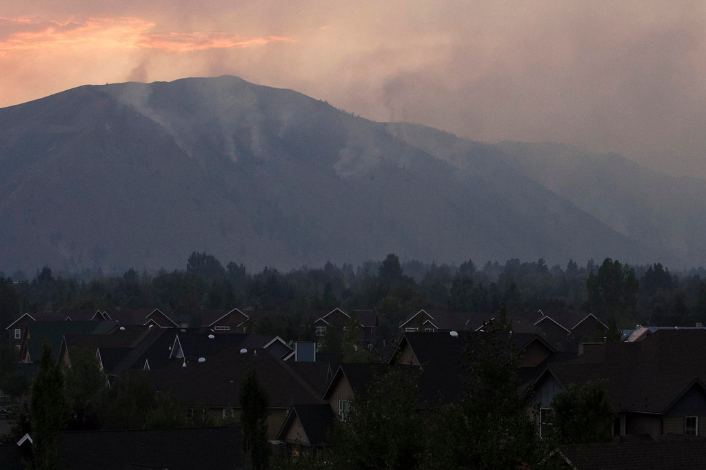 . Firefighters continue to battle the Beaver Creek Fire in the Wood River Valley where it creeps down the western canyon near Hailey Saturday Aug. 17, 2013. (AP Photo/Idaho Statesman, Darin Oswald)