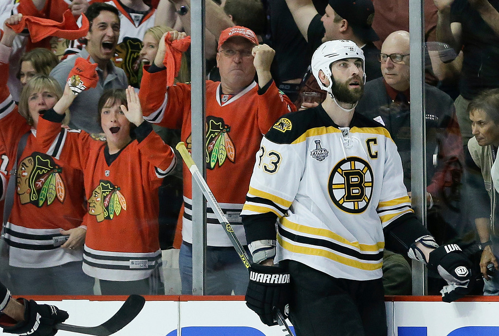 . Boston Bruins defenseman Zdeno Chara (33)  reacts after a late third period goal by the Chicago Blackhawks during Game 5 of the NHL hockey Stanley Cup Finals, Saturday, June 22, 2013, in Chicago. The Blackhawks won 3-1. (AP Photo/Nam Y. Huh)