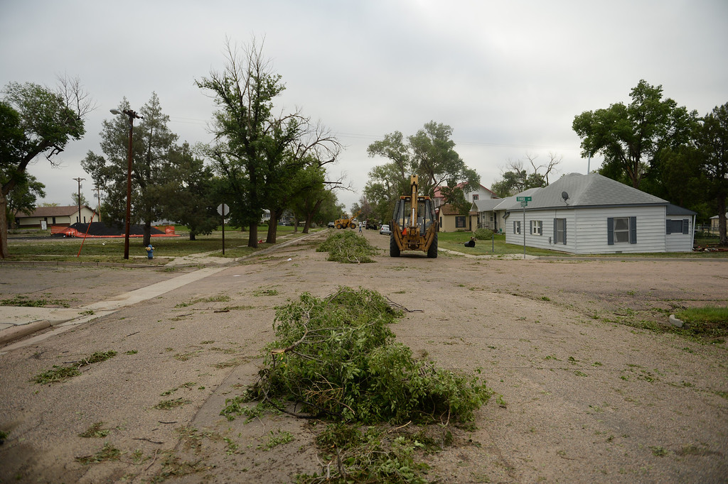 . Residents of Hugo clean up after a lager storm moved through town over night, June 5, 2014. (Photo by RJ Sangosti/The Denver Post)
