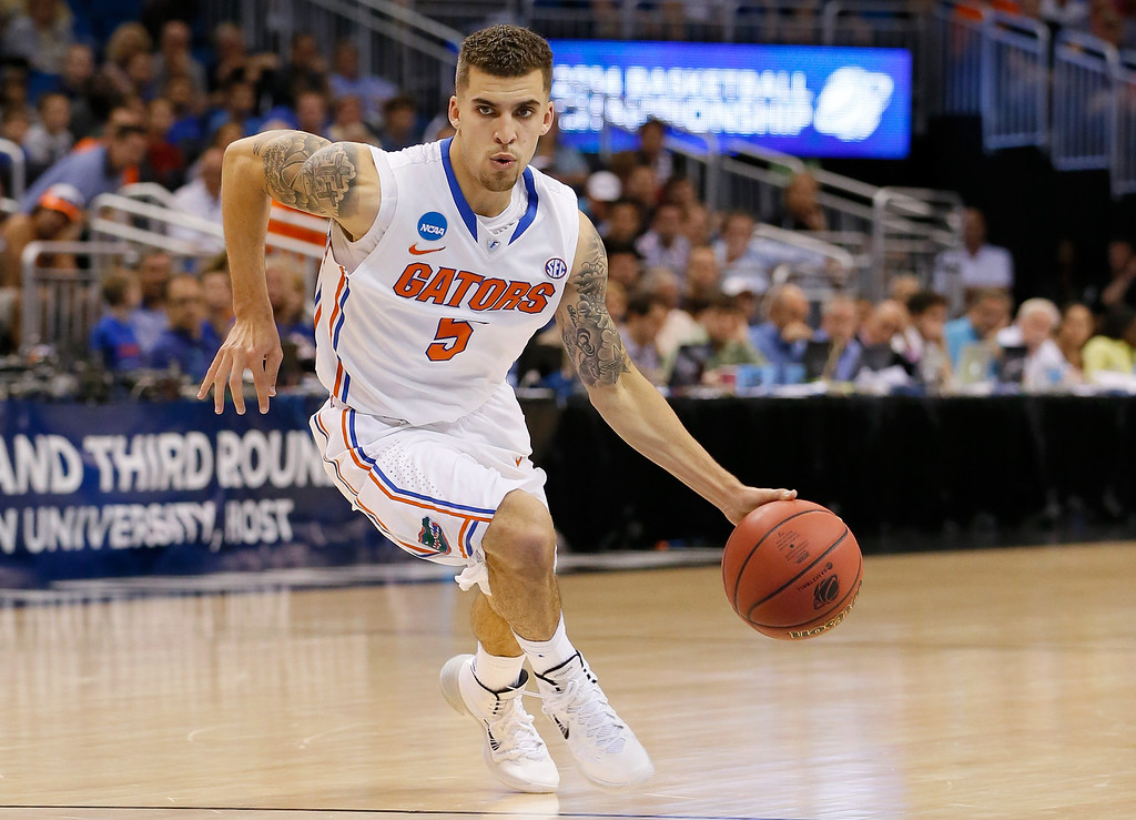. ORLANDO, FL - MARCH 20:  Scottie Wilbekin #5 of the Florida Gators drives in the first half against the Albany Great Danes during the second round of the 2014 NCAA Men\'s Basketball Tournament at Amway Center on March 20, 2014 in Orlando, Florida.  (Photo by Kevin C. Cox/Getty Images)