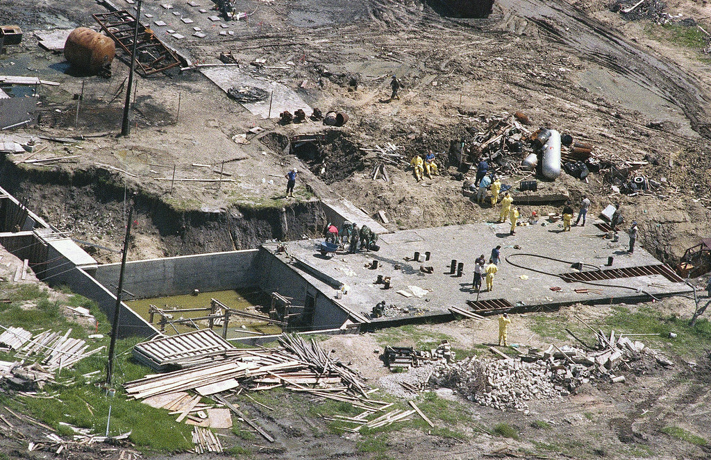 . Investigators work on top of the underground bunker at the Branch Davidian compound near Waco, Texas on Monday, May 3, 1993 as the search continues for more bodies at the burned out compound. The heavily armed religious sectís complex burned on April 19, killing an estimated 72 people. (AP Photo/Ron Heflin)