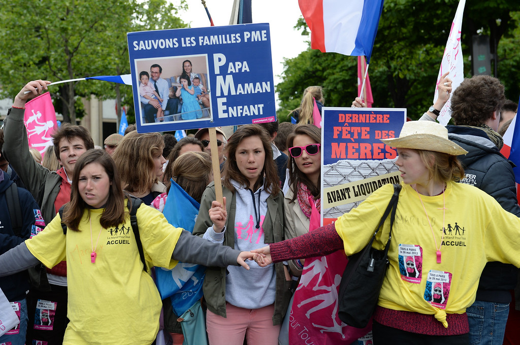 ". Supporters of the anti-gay marriage movement ""La Manif Pour Tous\"" (Demonstration for all) hold placards as they gather near the Invalides square in Paris on May 26, 2013 during a mass protest against a gay marriage law. France on May 18 became the 14th country to legalize same-sex marriage after President Francois Hollande signed the measure into law following months of bitter debate and demonstrations. Tens of thousands marched through Paris today to protest a new gay marriage law, with police on high alert amid warnings hardliners could infiltrate the demonstration and cause trouble.   ERIC FEFERBERG/AFP/Getty Images"