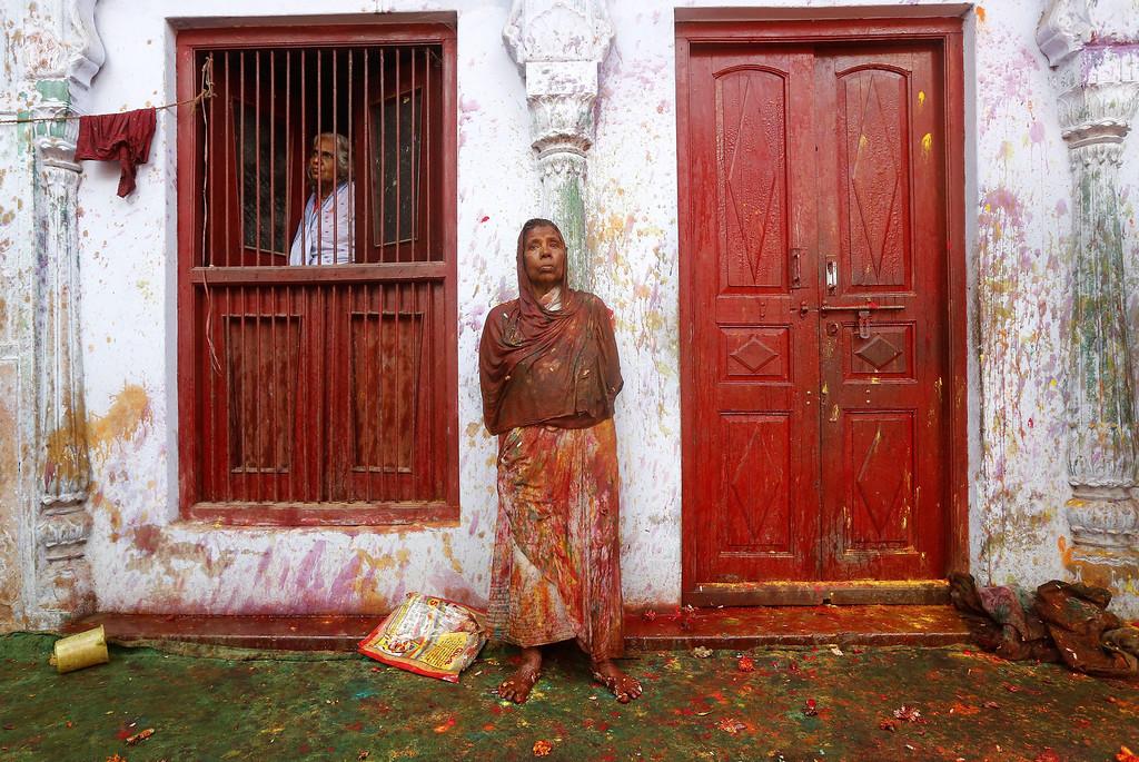 . Indian elderly widows look on as others  participate in the Holi festival in Vrindavan, Uttar Pradesh, India, March 14, 2014.  EPA/HARISH TYAGI  EPA/HARISH TYAGI