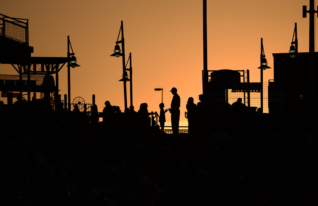 . DENVER JUNE 06: Baseball fans are silhouetted in the fading light at Coors Field. The Colorado Rockies hosted the Los Angeles Dodgers in Denver, Colorado June 6, 2014. (Photo by Hyoung Chang/The Denver Post)