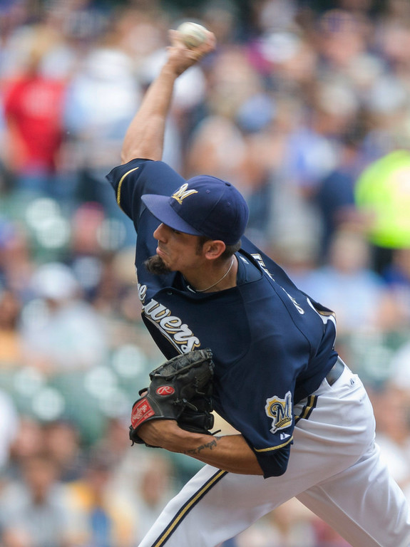 . Matt Garza of the Milwaukee Brewers\' pitches to Charlie Blackmon of the Colorado Rockies\' during the first inning of a baseball game Saturday, June 28, 2014, in Milwaukee. (AP Photo/Tom Lynn)