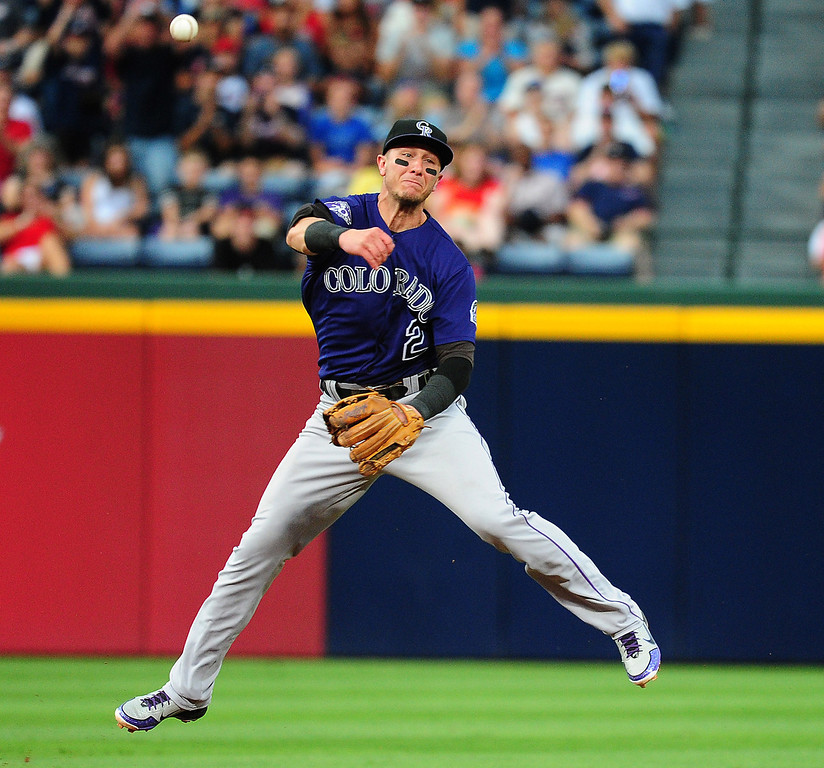 . Troy Tulowitzki #2 of the Colorado Rockies throws out a runner against the Atlanta Braves at Turner Field on July 29, 2013 in Atlanta, Georgia. (Photo by Scott Cunningham/Getty Images)