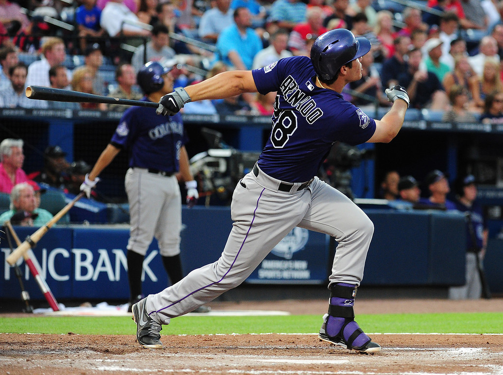 . Nolan Arenado #29 of the Colorado Rockies hits a fourth inning home run against the Atlanta Braves at Turner Field on July 29, 2013 in Atlanta, Georgia. (Photo by Scott Cunningham/Getty Images)