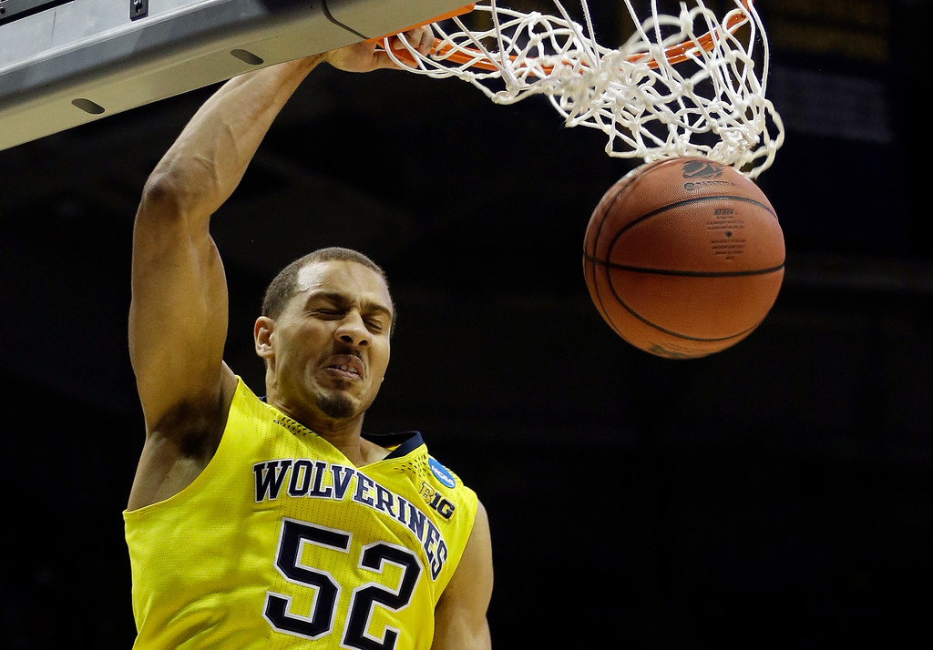 . Michigan forward Jordan Morgan (52) dunks during the first half of a second round NCAA college basketball tournament game against the Wofford Thursday, March 20, 2014, in Milwaukee. (AP Photo/Morry Gash)