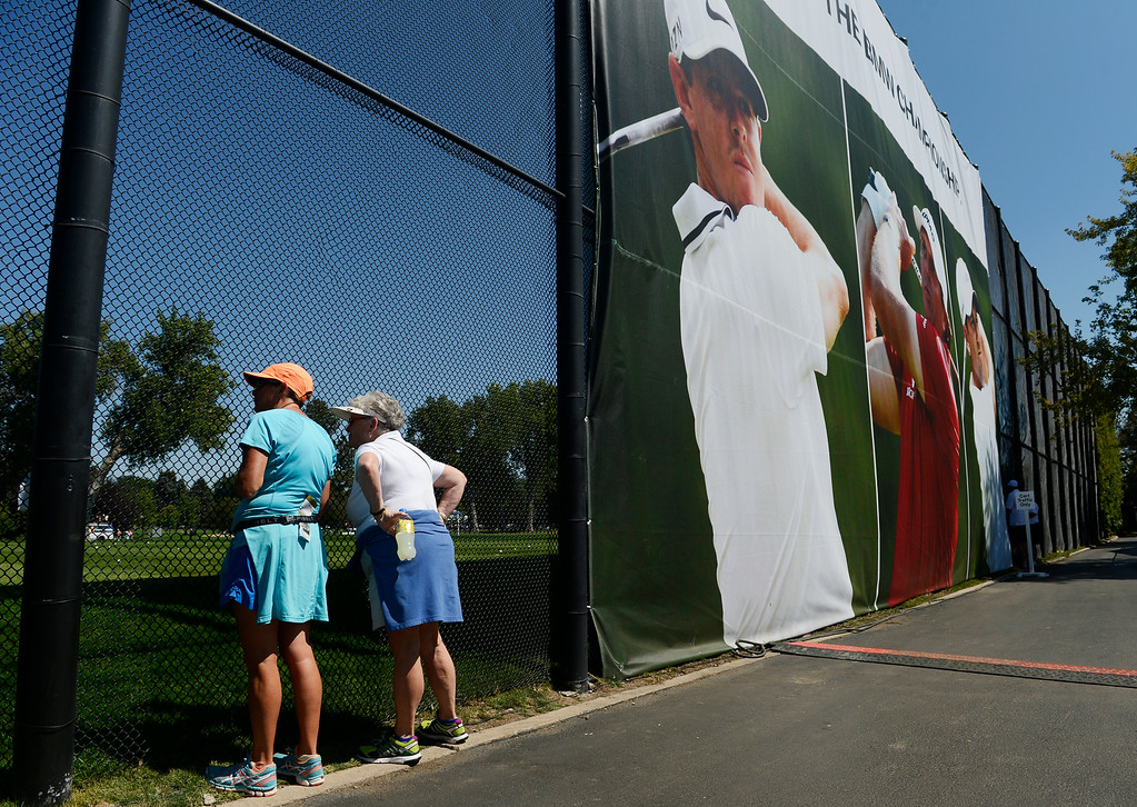 . CHERRY HILLS VILLAGE, CO. - SEPTEMBER 02:  Sisters, Kathy Dinmore, left, and Margret Gustafson, right, gets a first-hand look at golfers practicing on the driving range at the FedExCup BMW Championship at the Cherry Hills Country Club Tuesday, September 02, 2014 (Photo By Andy Cross / The Denver Post)