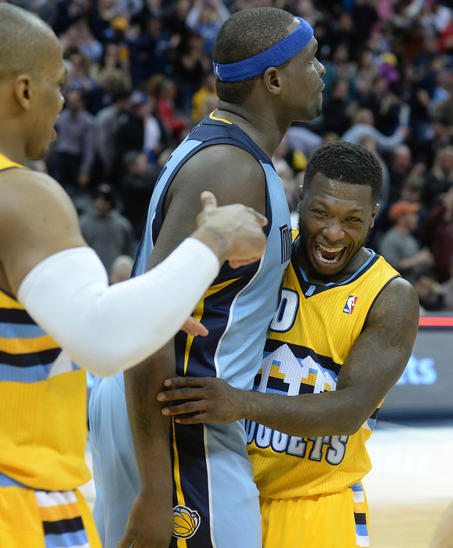. DENVER, CO. - JANUARY 03:  Denver guard Nate Robinson (10) had a little fun with Memphis forward Zach Randolph at the end of the game. The Denver Nuggets broke an eight-game losing streak with a 111-108 win over the Memphis Grizzlies at the Pepsi Center Friday night, January 3, 2014. Photo By Karl Gehring/The Denver Post