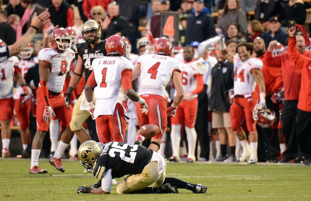 . Utah Safety Brian Blechen (4) celebrates a game-winning interception from University of Colorado quarterback Nick Mirschman as Colordado\'s Gerard Thomas remains on the field at the end of the game at Folsom Field in November, 2012. Utah won 42-35. Hyoung Chang, The Denver Post